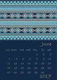 2017 Calendar planner with ethnic cross-stitch ornament on dark blue background Week starts on Sunday Stock Photo