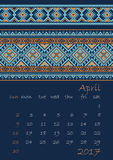 2017 Calendar planner with ethnic cross-stitch ornament on dark blue background Week starts on Sunday Royalty Free Stock Image