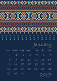 2017 Calendar planner with ethnic cross-stitch ornament on dark blue background Week starts on Sunday. Vector illustration. From collection of Balto-Slavic Royalty Free Stock Photos