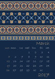 2017 Calendar planner with ethnic cross-stitch ornament on dark blue background Week starts on Sunday Stock Photo