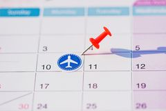 Calendar with push pin and plane stickers. Travel and money concept royalty free stock photo