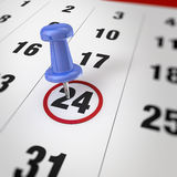 Calendar and pushpin. Calendar and blue pushpin. Mark on the calendar at 24 Royalty Free Stock Photography