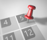 Calendar and pushpin. Calendar and red pushpin. Mark on the calendar at 5 Stock Images