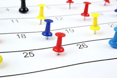 Calendar with pushpins Stock Image