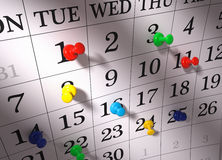 Calendar with pushpins Stock Images