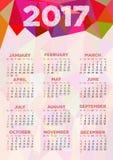 Calendar rastret för 2017 år med den abstrakta polygonal prydnaden Royaltyfria Bilder