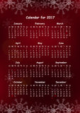 Calendar for 2017 on Red Background. With showflakes. Week Starts Sunday. US holidays. Simple Vector Template Stock Photos
