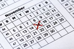 Calendar red cross date on the macro view royalty free stock image