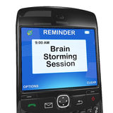 Calendar reminder, brain storming session. Concept image of smartphone wit reminder to have brain storming session Royalty Free Stock Image