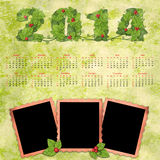 Calendar 2014 with a retro photo frames. On textured background vintage Royalty Free Stock Photography