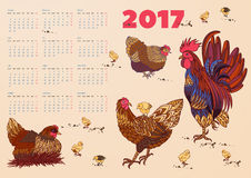 2017 calendar with rooster, hens and chickens. Week starts on Monday Stock Photography