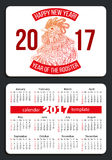 Calendar 2017 with rooster. Sunday start pocket calendar 2017. Rooster - symbol of the year 2017. Vector Royalty Free Stock Photo