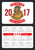 Calendar 2017 with rooster. Sunday start pocket calendar 2017. Rooster - symbol of the year 2017. Vector Stock Images
