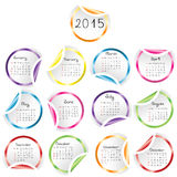 2015 Calendar with round glossy stickers. Over white Vector Illustration