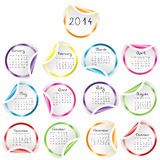 2014 Calendar with round glossy stickers. Over white Stock Images
