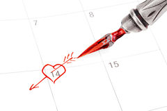 Calendar with Saint Valentine's date marked out with ink pen. By heart symbol stock illustration