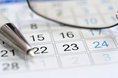 Calendar scheduler in the workplace manager royalty free stock photo