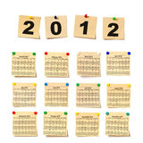 Calendar on set note 2012. Paper a note attached to a wall buttons, it is isolated on a white background Royalty Free Stock Image