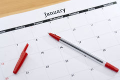 Calendar Sheet January. Generic empty calendar sheet for January with red pen, fill in your own New Year's resolution Royalty Free Stock Photo