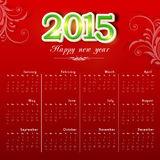 2015 calendar with shiny text. Beautiful  2015 calendar with shiny text and floral design on red background Stock Photo