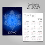Calendar 2016 with snowflake closeup in starry sky. Calendar 2016 with white snowflake closeup in starry sky Stock Photography