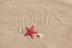 Calendar with starfish and seashells on sand beach. Cover Royalty Free Stock Images