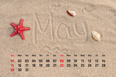 Calendar with starfish and seashells on sand beach. May 2016 Royalty Free Stock Image