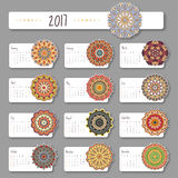 Calendar 2017 start sunday with hand drawn mandala. Vintage orie. Ntal style. Vector illustration Stock Photos