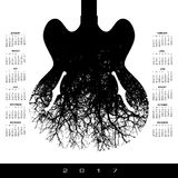 A 2017 calendar with a stunning image of a guitar. And tree Royalty Free Stock Image