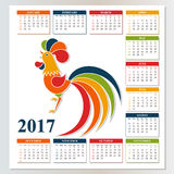 Calendar 2017 from Sunday to Saturday. Chinese New Year Red Rooster.  Royalty Free Stock Photos