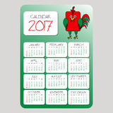 Calendar. Symbol of the year. Red Rooster on the Chinese calendar. Rounded rectangle cartoon cock. Template with week. Calendar 2017. Symbol of the year. Red Stock Photos