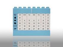 Calendar tegelstenleksakisolering på vit med skugga Arkivfoton