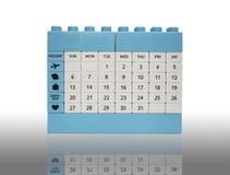 Calendar tegelstenleksakisolering på vit med skugga Arkivbild