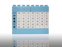 Calendar tegelstenleksakisolering på vit med skugga Fotografering för Bildbyråer