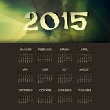 Calendar 2015 Template with Green and Yellow Triangular Geometric Background Stock Image