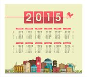 Calendar 2015. Template text calendar for 2015 on a poster with cityscape on the figures, the rooster weathervane Royalty Free Stock Images