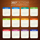 Calendar template for 2017. Calendar for 2017 on Wooden Background. Week Starts Sunday. Simple Vector Template. For web and print design. Vector illustration Stock Photos