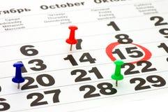 Calendar and Thumbtack close up Stock Photo