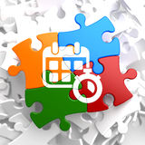 Calendar with Timer Icon on Multicolor Puzzle. Stock Photography