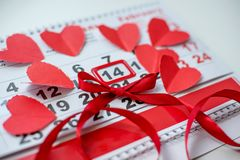 Calendar to Valentines day with red paper hearts stock image