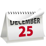 Calendar Turns Page to Christmas DECEMBER 25. A calendar turns a page to change to DECEMBER 25 Christmas day a red letter day Royalty Free Stock Photography
