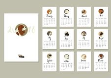 Calendar with twelve different dogs Cover with Cavalier Stock Images