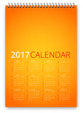 Calendar 2017 Vector. Simple calendar 2017 orange colored template. Week starts from sunday. Vector realistic spiral notepad notebook royalty free illustration