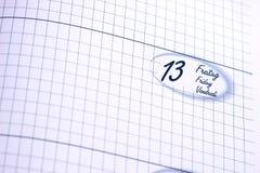 Calendar visningen fredag 13th, fredag i franskt, engelskt, tysk Royaltyfri Foto