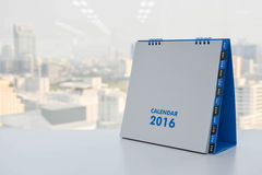 Calendar of 2016. On the white table with city view background Royalty Free Stock Images