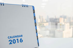 Calendar of 2016. On the white table with city view background Stock Photography