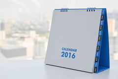 Calendar of 2016. On the white table with city view background stock illustration