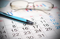 Calendar. Workplace with calendar, pen and glasses work table Royalty Free Stock Photography