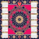 Calendar for 2018 year on ethnic ornamental background. Russian language. Calendar for 2018 year on ethnic ornamental background. Mandala pattern. Week starts Stock Photo