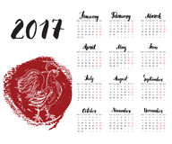 Calendar 2017 Year, With Hand Drawn Red rooster. Month Lettering, Week Starts Monday. Vector illustration. Calendar 2017 Year, With Hand Drawn Red rooster Royalty Free Stock Image